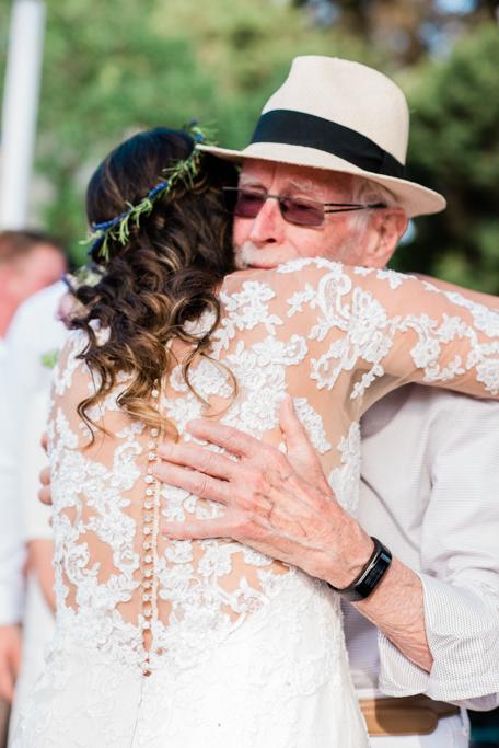 The grandfather and the bride. A precious moment at the wedding at Pura Vida, Ibiza. Photographer Masha Kart